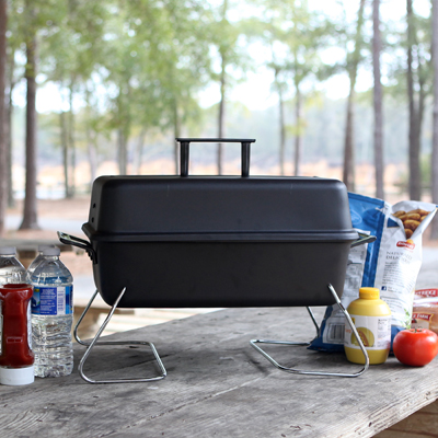 CHAR-BROIL<sup>&reg;</sup> Gas Tabletop Grill - Perfect for your next camping trip or tailgating party, this tabletop, gas grill is made of quality steel construction with a durable finish.  Features an easy to clean porcelain-coated cooking grid, heat resistant handles, 190 sq. inch cooking surface and convenient lid hanging feature.  Filtered regulator will protect your tank valve from sand and other debris.  LP tank not included.