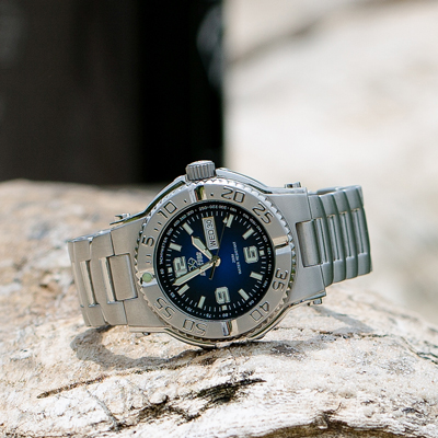 REACTOR<sup>®</sup> Critical Mass Degrading Blue Dial Stainless Steel Men's Watch - Built for durability, strength and style, this watch has a striking blue dial and handsome stainless steel band.  Features day/date display, Japanese quartz movement, unidirectional rotating bezel, marine-grade 316L  stainless steel case and caseback.  Water resistant up to 660 meters. Superluminova on hands and markers.